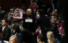 Protesters interrupt Brennan CIA confirmation hearing