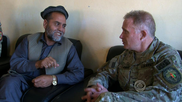 Special Operations Major General Tony Thomas talks to an Afghan man in his neighborhood.