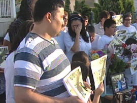 Family and friends of Ricardo Portillo hold vigil for him on front lawn of his Utah home on May 5, 2013 after soccer ref in rec league died from injuries suffered when he was  punched in head by angry teen goalie