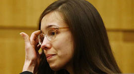 Jodi Arias reacts after she was found of guilty of first-degree murder in the gruesome killing her one-time boyfriend, Travis Alexander.