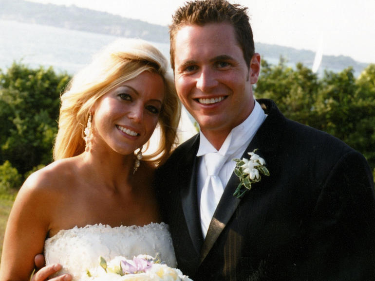 George and Jennifer Hagel smith on their wedding day