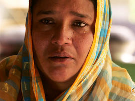 Hosne Ara Fahima believes factory owners paid for her her labor activist husband to be killed.