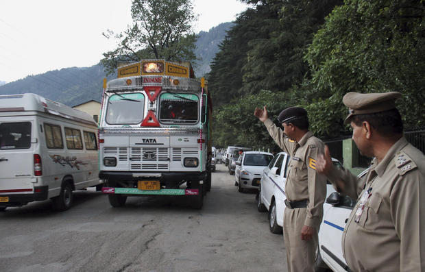 Indian policemen check vehicles after an American woman was gang-raped in the northern Indian resort town of Manali