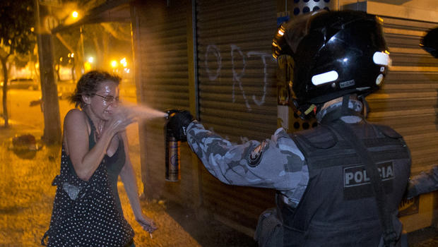 A military police peper sprays a protester during a demonstration in Rio de Janeiro, Brazil, June 17, 2013.