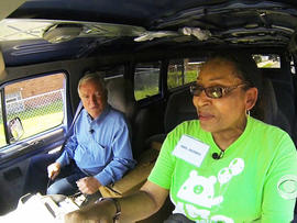 Dean Reynolds rides with Yolanda Morris in the van she uses to safely transport kids to camp in Chicago.