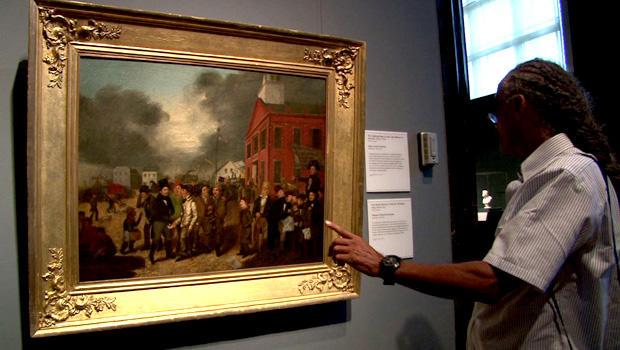 一名男子在底特律艺术学院观看伯纳姆托马斯米克尔1837年的一幅画。