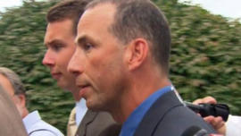 Sgt. Sean Murphy tells reporters â??life is goodâ?? as he walks into his hearing Tuesday.