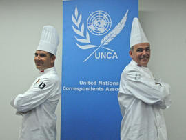 Chef Christian Garcia, left, who serves Prince Albert II of Monaco and as president of Club des Chefs des Chefs, and chef Mark Flanagan, who serves Britain's Queen Elizabeth II and as the group's vice president, pose at United Nations headquarters in New York July 29, 2013.