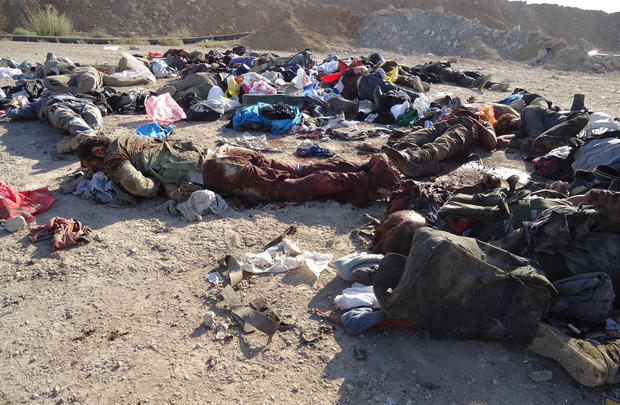 The bodies of rebel fighters are seen on the ground after an ambush by Syrian troops