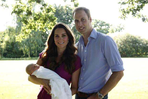 The Duke and Duchess of Cambridge and Prince George pose in early August in the garden of the Middleton family home in Bucklebury, England.