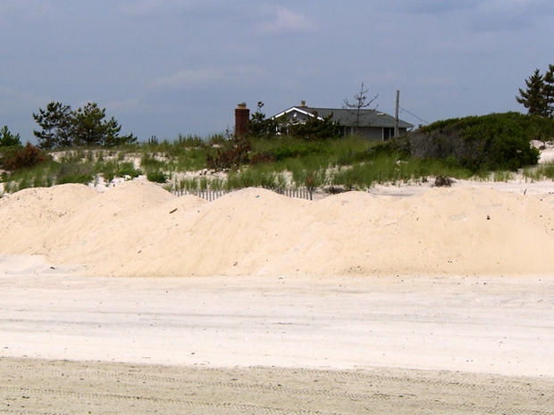 While some coastal towns say dunes offered protection, others say they wouldn't have stopped the Superstorm Sandy's massive surge.
