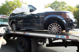 The Range Rover driven by Alexian Lien when he became involved in a confrontation in New York with several motorcyclists is moved to a police precinct, Saturday, Oct. 5, 2013.