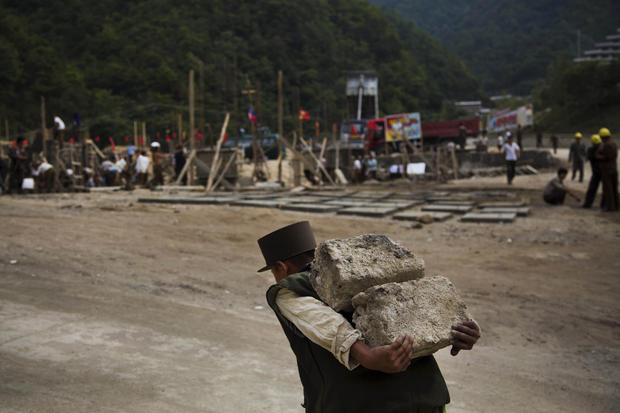 North Korean construction worker carries bricks at a building project to construct a ski resort at North Korea's Masik Pass.