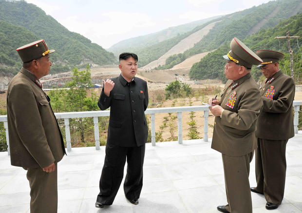 North Korean leader Kim Jong-Un speaks other officials at the Masik Pass Skiing Ground
