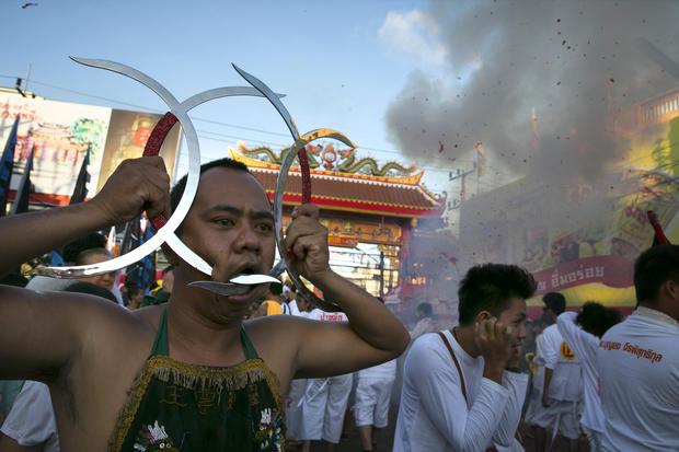 "Humans ""skewered"" at vegetarian festival"