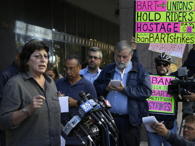 Roxanne Sanchez, left, president of Service Employees International Union Local 1021, speaks during a news conference