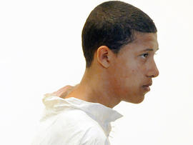 Philip Chism, 14, stands during his arraignment for the death of Danvers High School teacher Colleen Ritzer in Salem District Court in Salem, Mass., Oct. 23, 2013.