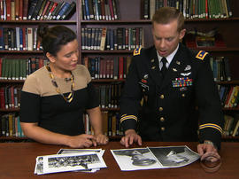 Army Maj.  Dwight Mears shows CBS News' Elaine Quijano photos of his grandfather, a U.S. airmen who was a POW in Switzerland.