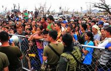 Tacloban residents urged to flee typhoon-ravaged city