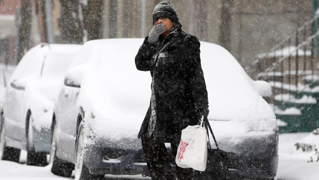 A pedestrian walks through morning snow Jan. 2, 2014, in Albany, N.Y.