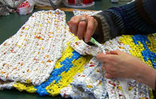 Crochet group transforms plastic bags into mats for the homeless