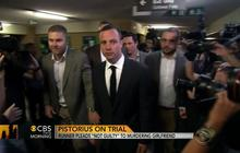 "Pistorius pleads ""not guilty"" to murdering girlfriend"