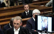 Pistorius gets sick in court after seeing graphic picture of girlfriend's body
