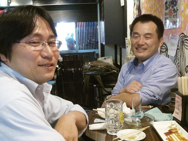 Fumio Terashita, right, enjoys one of the few perks of a receding hairline