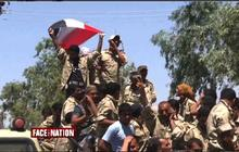 ISIS militants seize more territory in Iraq, take key border station