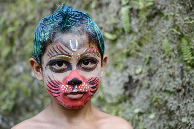 Painted parade wards off evil in Bali