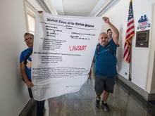 protesters-lawsuit-451329582.jpg