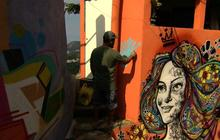 Artist transforms Brazilian neighborhood with street art