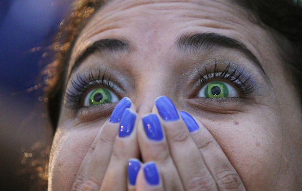 Faces of agony and ecstasy of German, Brazil fans