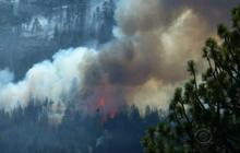 Calif. firefighters take aim at raging wildfires