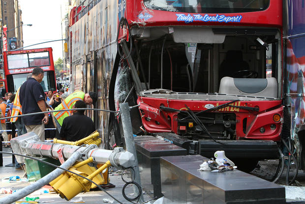 Tour buses collide in Times Square