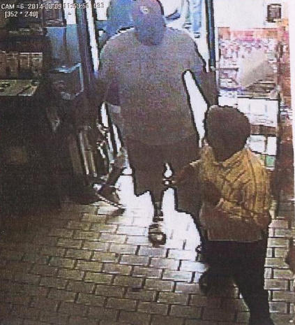 Surveillance video of store robbery in Ferguson