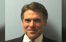 Texas Gov. Perry turns himself in, vows to fight