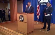 Holder announces Justice Department probe into Ferguson police