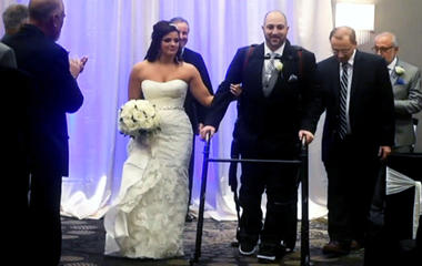 Paralyzed man accompanies bride down the aisle