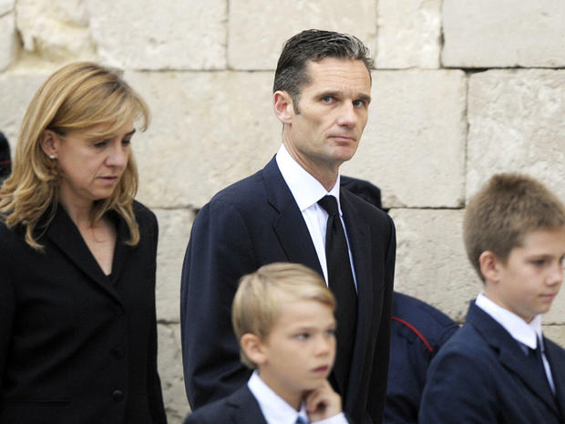 File photo shows Spain's Princess Cristina and her husband, former Olympic handball player Inaki Urdangarin and their family at funeral of his father in May 2012