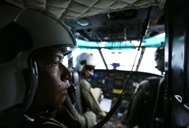 Indonesia Air Force members are seen inside a Super Puma helicopter during search of Java Sea, off Indonesia, on January 7, 2015, for passengers from AirAsia Flight 8501