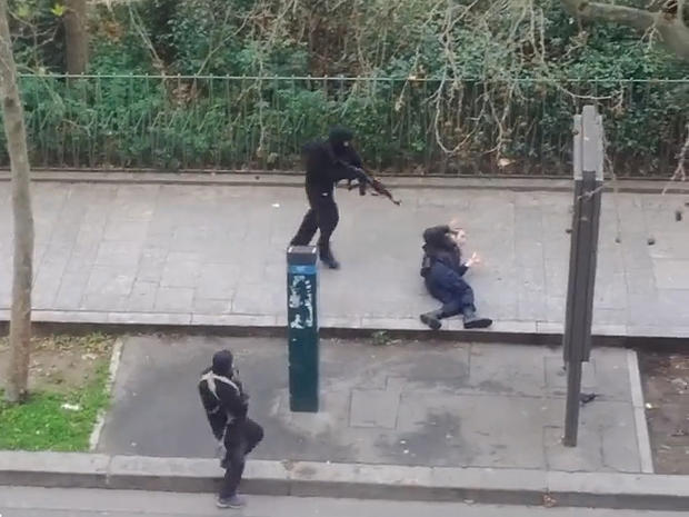 An image from video posted online shows masked gunmen just before one of them appears to shoot a Paris police officer at close range, following an attack on the office of weekly newspaper Charlie Hebdo