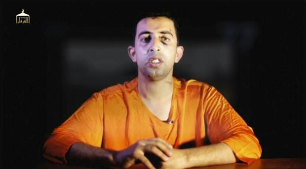 A man purported to be ISIS captive Jordanian pilot Muath al-Kasaesbeh speaks in still image from undated video filmed in undisclosed location made available on social media on February 3, 2015