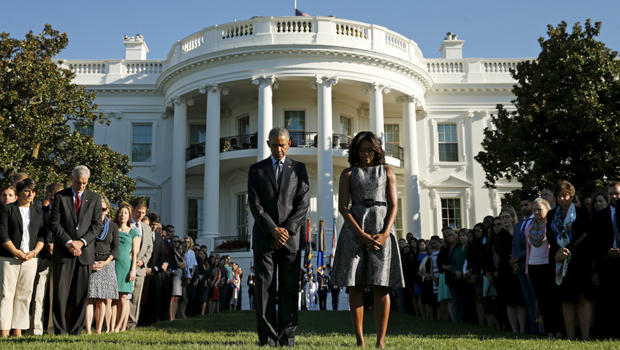 President Obama and first lady Michelle Obama observe a moment of silence on the South Lawn of the White House to mark the 14th anniversary of the 9/11 attacks in Washington Sept. 11, 2015.