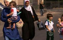 Family flees Syria for third time