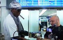Dennis Rodman returns from North Korea