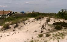 Coastal communities debate sand dunes after Sandy