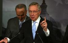 """Reid: GOP putting """"gun to the head"""" of American people"""