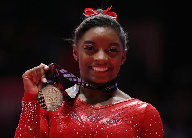 U.S. gymnast earns record world championship gold medals ...