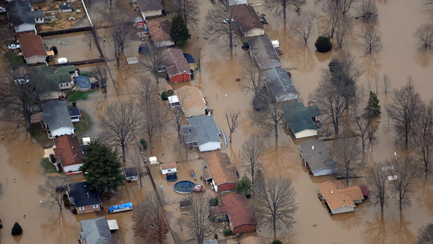 A neighborhood is submerged in floodwaters from the cresting Meremac River Dec. 31, 2015, in Arnold, Missouri. The St. Louis area and surrounding region are experiencing record flood crests of the Mississippi, Missouri and Meremac rivers after days of rec